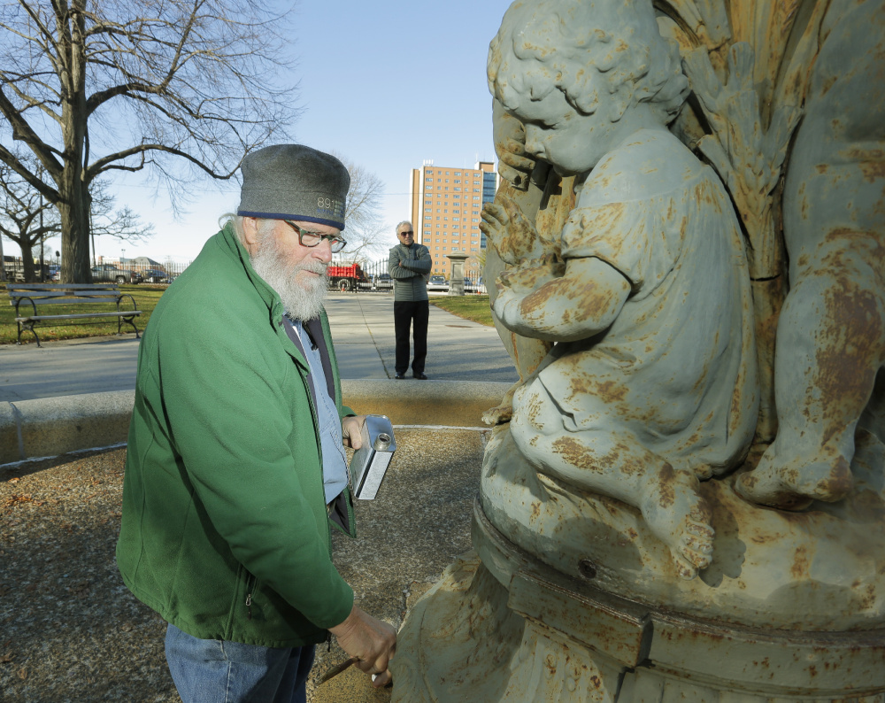 Jonathan Taggart says that after he removes rust and paint, then applies a new finish, Lincoln Park will have a deep-green fountain that will look as good as can be expected for a 145-year-old piece of iron.