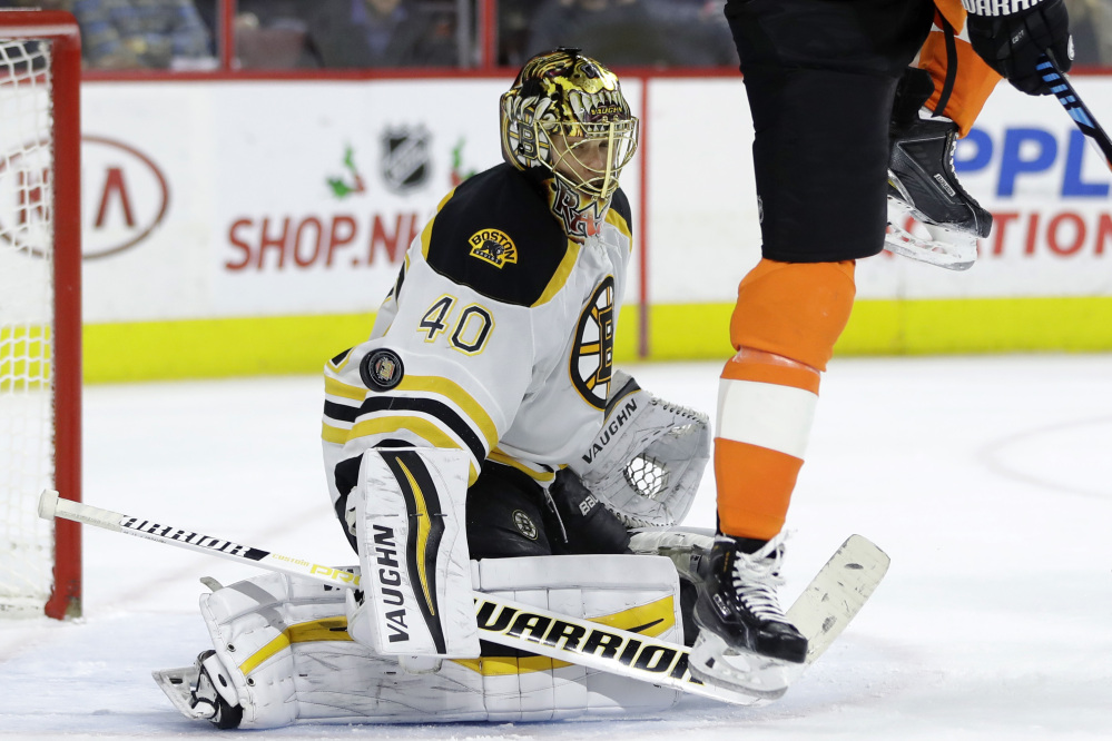 Bruins goalie Tuukka Rask blocks a shot as the Flyers' Wayne Simmonds tries to screen on a shot in the second period Tuesday night in Philadelphia.