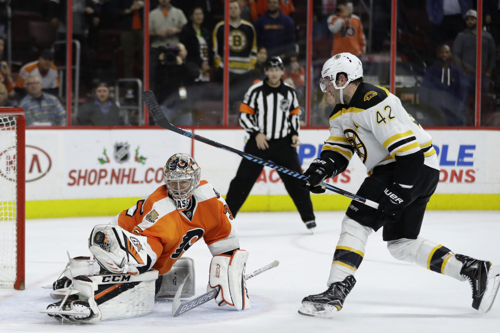 Philadelphia goalie Steve Mason blocks a shot by the Bruins' David Backes to end the overtime shootout and give the Flyers a 3-2 win Tuesday night.