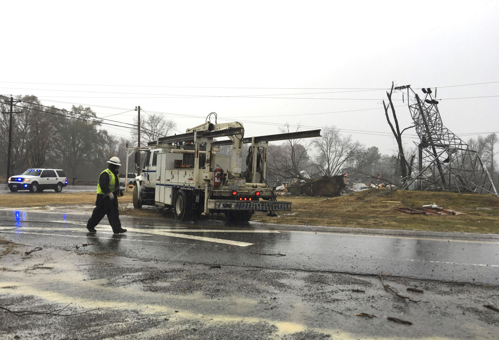 Responders prepare to leave the site of a damaged transformer in Benton Tenn., on Wednesday. Thunderstorms dumped much-needed rain on eastern Tennessee overnight as thousands of people waited anxiously for news about their homes after wildfires tore through the area.