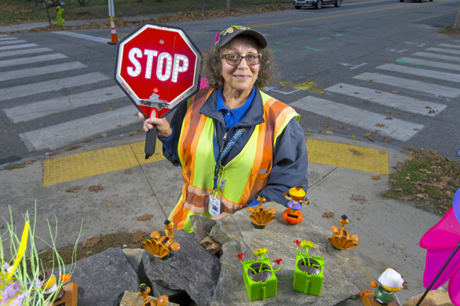 Michele Danois, crossing guard, at her daily location at the corner of Thompson and Pillsbury streets.