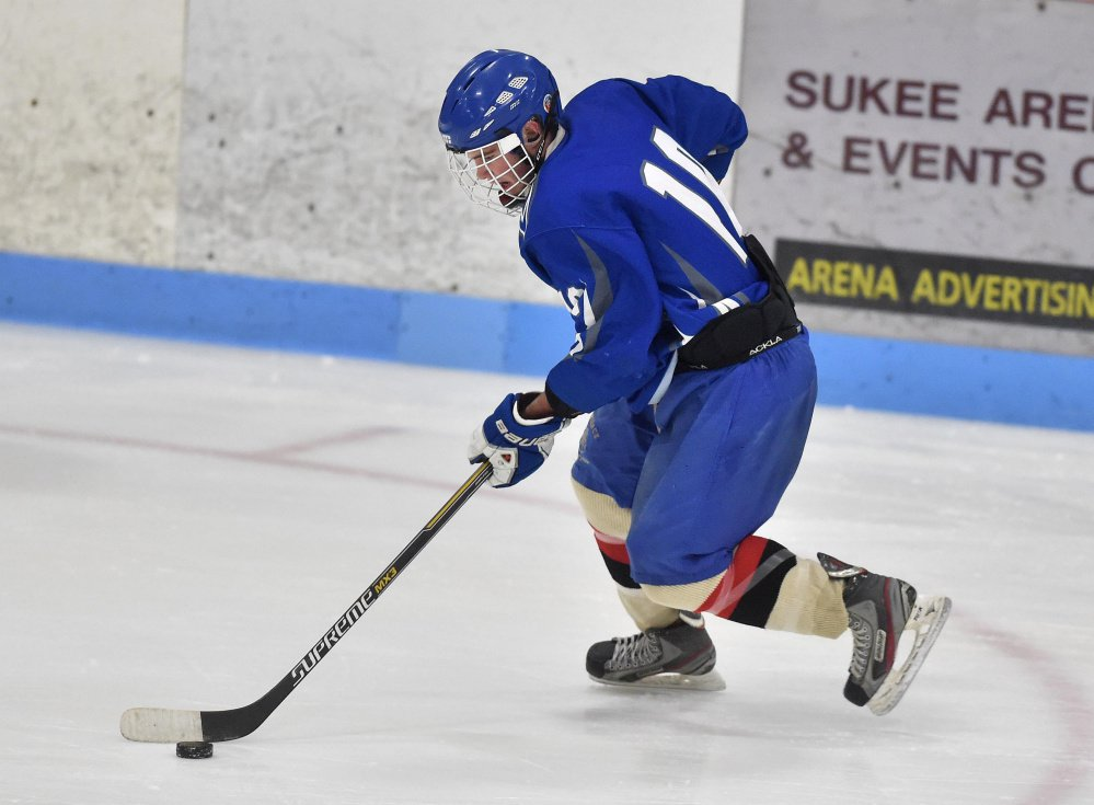 Skowhegan/Lawrence High School's Brady Martin works out at practice Nov. 17, 2015, at Sukee Arena in Winslow. The arena is experiencing problems with equipment it uses to make ice for the hockey season.