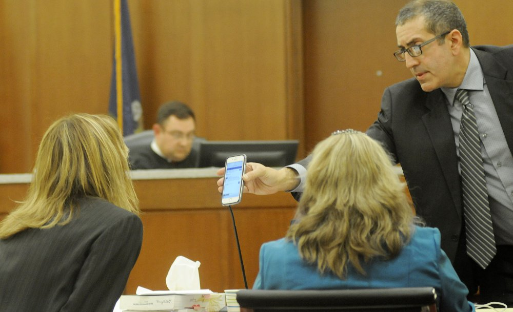Defense attorney Charles Ferris shows Assistant District Attorney Tracy DeVoll a message Tuesday on Danielle Jones' cellphone during Jones' trial in Augusta.