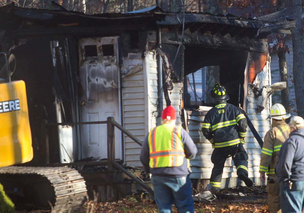 The scene in the aftermath of the fire at 10 Pettingill Road that killed Marie McAllister early Friday morning in Windham.