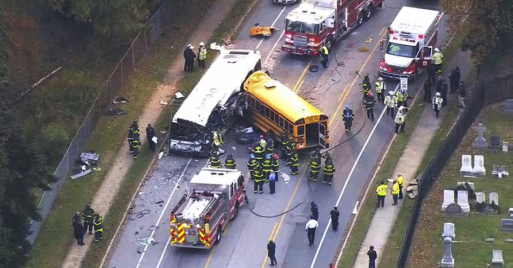 Emergency personnel work at the scene of a fatal bus crash in Baltimore on Tuesday.