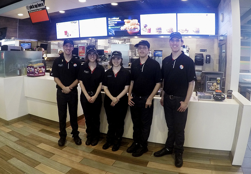 Quintuplets Lucas, Lauren, Lindsey, Leith and Logan Curtis, left to right, pose in a McDonald's in Potterville, Mich.