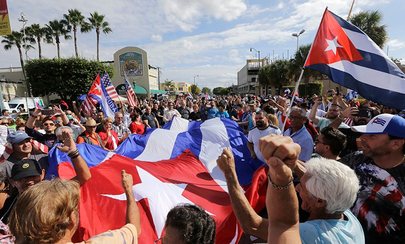 Cuban-Americans react to the death of Fidel Castro on Saturday in the Little Havana area in Miami.