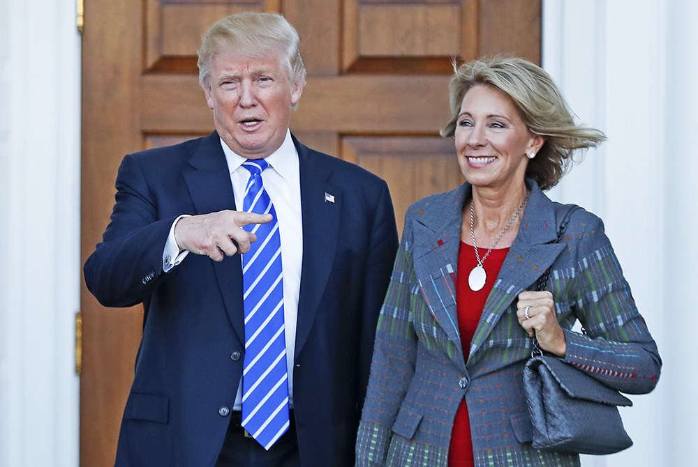 President-elect Donald Trump and Betsy DeVos pose for photographs at Trump National Golf Club Bedminster clubhouse in Bedminster, N.J., Nov. 19, 2016. <em>Associated Press/Carolyn Kaster</em>