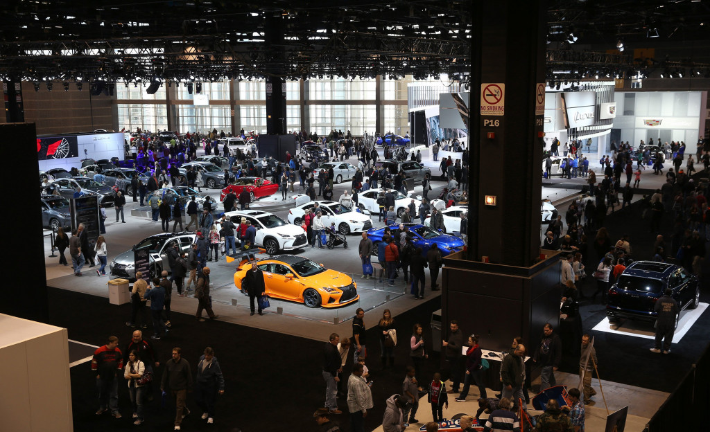 Thousands of people flock to see new cars debuting at the Chicago Auto Show in February of this year.