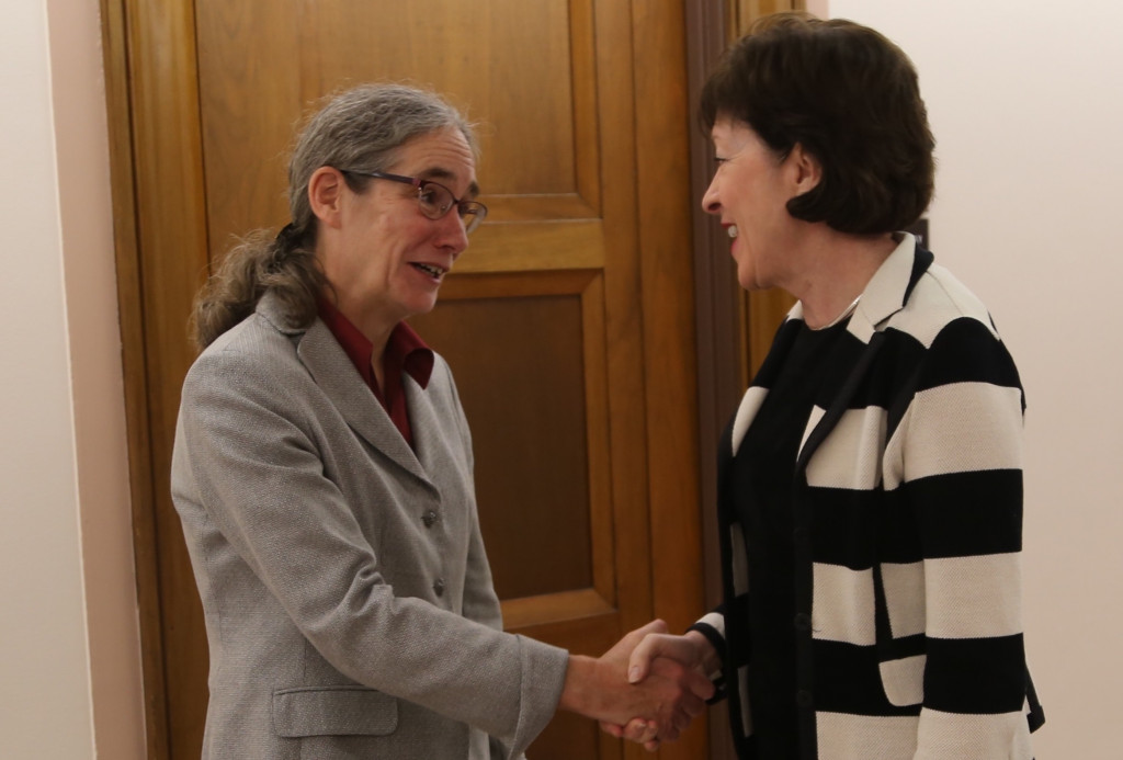 Sen. Susan Collins greets Jaye Martin, director of Maine Legal Services for the Elderly, on Wednesday in Washington.