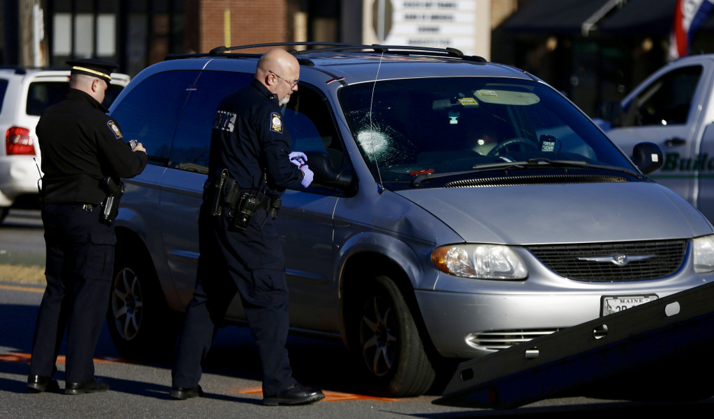 Portland police examine a car after a pedestrian was hit on Forest Avenue on Tuesday morning.