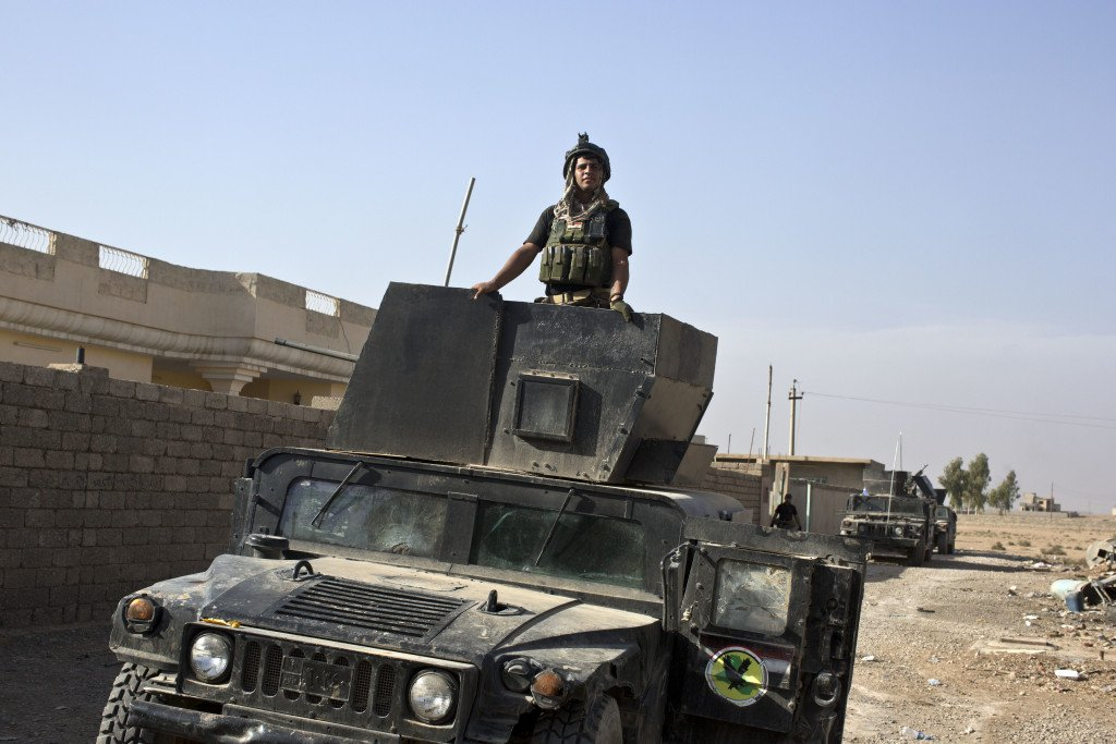 A member of the Iraqi special forces stands atop a Humvee in the village of Bazwaya, near the center of Mosul on Monday. Special forces entered Mosul on Tuesday in an offensive to drive out Islamic State militants. <em>Associated Press/Marko Drobnjakovic</em>