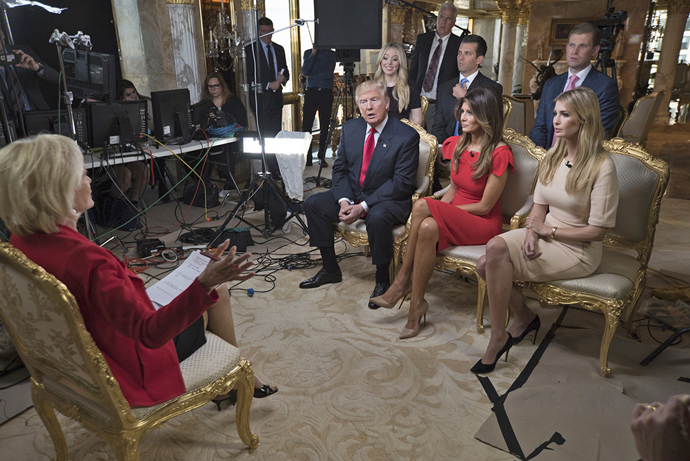 """""""60 Minutes"""" correspondent Lesley Stahl interviews President-elect Donald J. Trump and his wife, Melania, daughter Ivanka, seated right, daughter Tiffany, seated second row from left, and sons Donald Jr. and Eric at his home in New York on Friday. The first post-election interview for television was broadcast on Sunday. <em>Chris Albert for CBSNews/60 Minutes via AP</em>"""