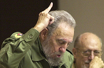 Cuba's leader Fidel Castro, left, votes in favor of the modification on the Cuban Constitution in this 2002 photo, as his brother, Defense Minister Raul Castro, looks on during an extraordinary National Assembly session in the Convention Palace in Havana, Cuba. Fidel Castro led a rebel army to improbable victory in Cuba, embraced Soviet-style communism and defied the power of 10 U.S. presidents during his half century rule. Associated Press File Photo/Cristobal Herrera