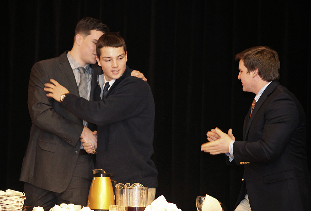 Joe Esposito of Portland High, center, is congratulated by fellow finalists Austin McCrum of Thornton Academy, left, and Will Bessey of Brunswick after he was awarded the 45th James J. Fitzpatrick Trophy during a ceremony in Portland on Jan. 24. Eleven semifinalists were announced Wednesday for this season's Fitzpatrick Trophy. <em>Jill Brady/Staff Photographer</em>