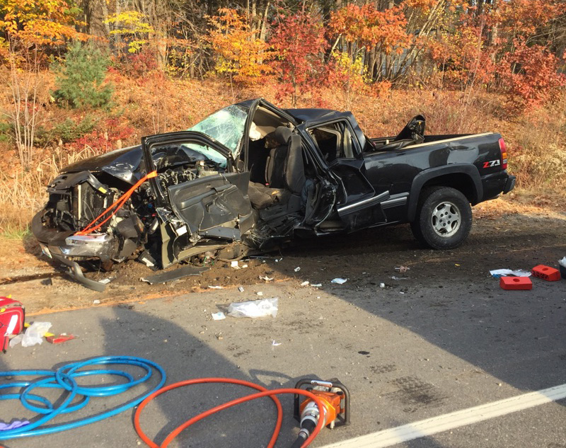 The wreckage of the pickup truck operated by Luke Fleurant is shown on Route 202 Tuesday morning. <em>Photo courtesy of Maine Department of Public Safety</em>