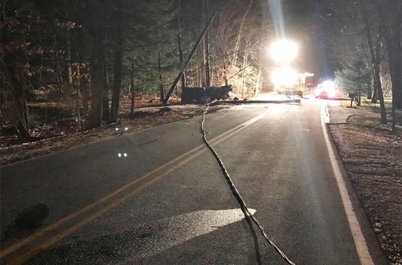 Emergency crews and police at the scene Wednesday night of a crash on Dow Road in Standish, where a  pickup truck had struck utility poles and caught fire. In the foreground is one of the downed power lines. <em>Photo courtesy of Cumberland County Sheriff's Office</em>