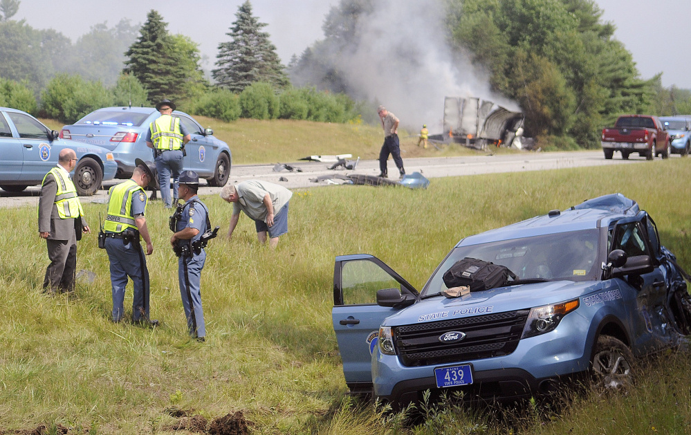 State police respond to a crash on Interstate 295 in Richmond that injured Trooper Greg Stevens in July 2015. The tractor-trailer that hit his cruiser, right, crashed and burned in the median. The driver was charged with failing to move over for an emergency vehicle.
