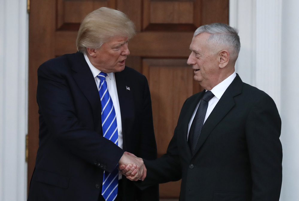 President-elect Donald Trump shakes hands with retired Marine Corps Gen. James Mattis on Nov. 19 as he leaves Trump National Golf Club Bedminster clubhouse in Bedminster, N.J. Trump said at a rally Thursday that he will nominate Mattis as defense secretary.