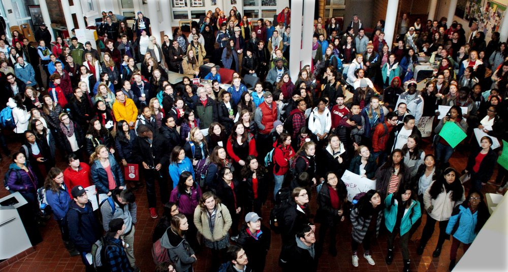 Colby College students and staff assemble in the Student Union to hear speakers before marching at the campus in Waterville on Thursday.