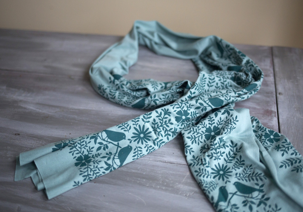 A hand-printed Morris + Essex scarf made of sustainable bamboo-cotton jersey fabric.