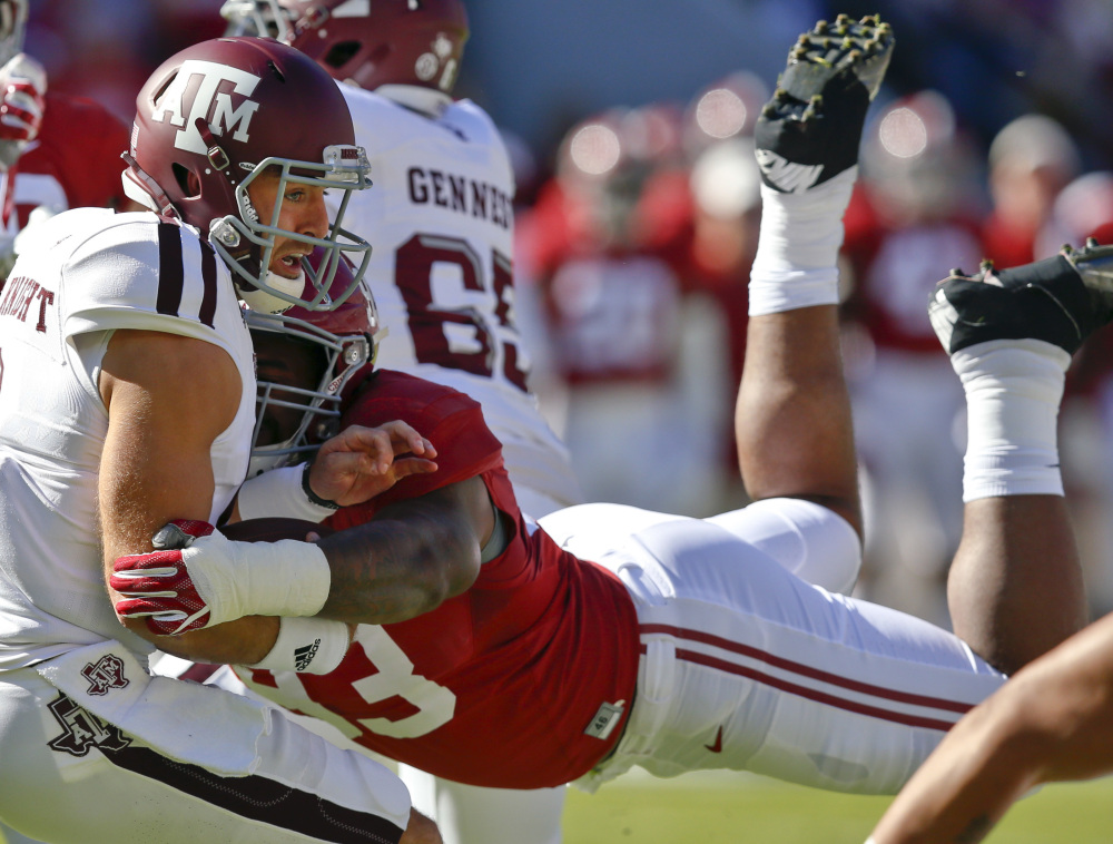 Alabama defensive lineman Jonathan Allen sacks Texas A&M quarterback Trevor Knight during their Oct. 22 game. Allen has 52 tackles and 11.5 sacks to lead the Crimson Tide's stingy defense.