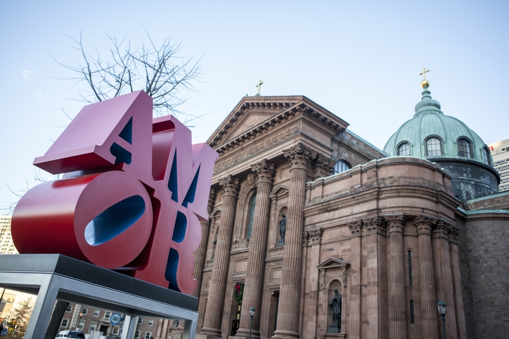 Robert Indiana's AMOR sculpture occupies a spot in a park outside Philadelphia's Cathedral Basilica of Saints Peter and Paul. Officials say the sculpture, originally loaned to Philadelphia for last year's papal visit, will permanently remain in the city.