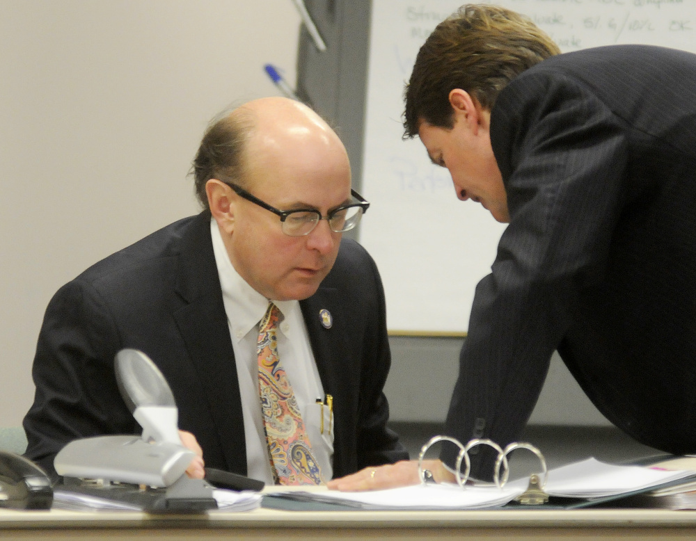 Newell Augur of the No on 1 Campaign, right, confers Monday with Secretary of State Matt Dunlap during a recount in Augusta on the referendum question to legalize recreational marijuana in Maine.