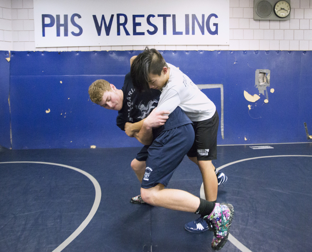 Portland High wrestlers Zach Elowitch, left, and Ben Levine start their drive toward a state championship come February, but both began before high school in a feeder program that benefits Portland, Deering and Cheverus.
