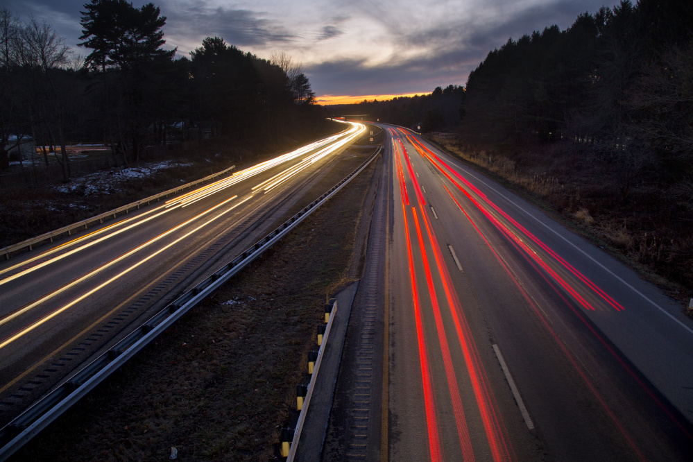 Steady traffic and a long camera exposure create light trails Thursday on I-295 in Falmouth. Crashes on the road jumped 32 percent from 2013 to 2015, and the Maine Department of Transportation is studying the many variables that lead to crashes, including speed, volume and distracted driving. Derek Davis/Staff Photographer