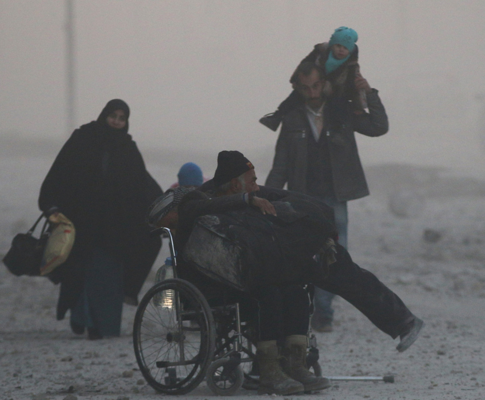 Civilians flee to a rebel-held area of Aleppo, Syria, on Friday. Hundreds of men have vanished and are feared captured.
