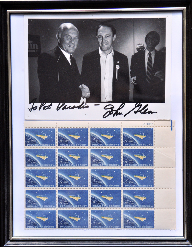 This autographed picture from 1983 shows the late Sen. John Glenn, left, and Patrick Paradis when the two met in Augusta while Glenn was campaigning for the 1984 Democratic presidential nomination. Framed with it is a sheet of stamps commemorating Glenn's 1962 space flight in the Mercury program.