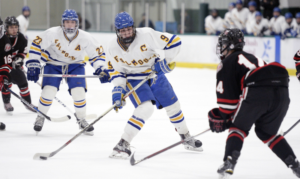 Falmouth's Robbie Armitage takes the puck up ice against Scarborough during a 3-3 tie Tuesday night at Family Ice Center in Falmouth. Armitage scored twice to get the Yachtsmen out of a 2-0 hole.