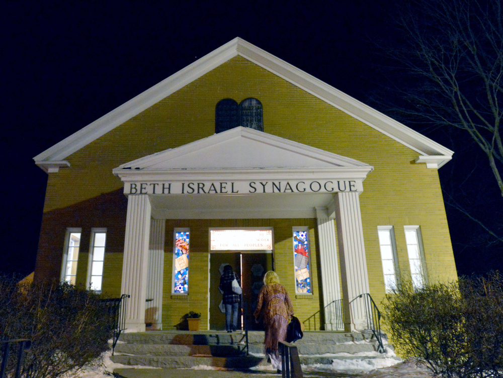 People gather at an interfaith service Friday evening at Beth Israel Congregation in Waterville in response to a swastika being painted on a rock at a city-owned park.