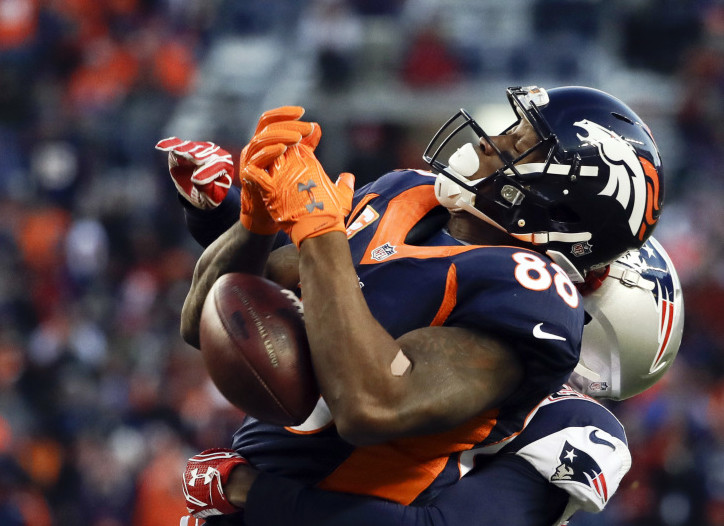 Broncos wide receiver Demaryius Thomas can't hang on to a pass under pressure from Patriots strong safety Patrick Chung during the second half of Sunday's game in Denver. The Patriots won, 16-3.