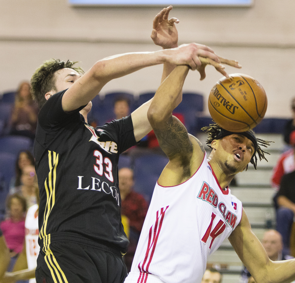 Erie BayHawks center Stephen Zimmerman, left, and Maine Red Claws guard Damion Lee fight for a rebound during Sunday's game at the Portland Expo. The Red Claws lost, 108-104.