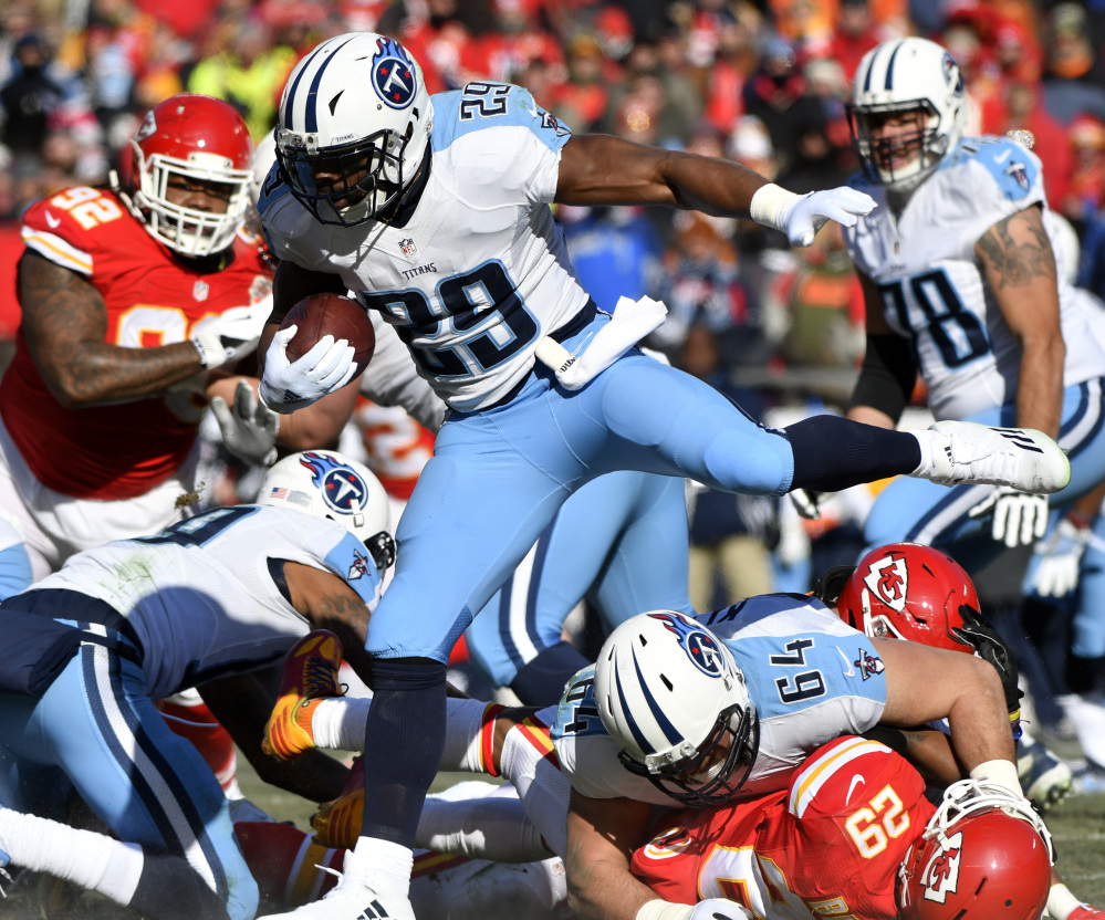 Titans running back DeMarco Murray hurdles lineman Josh Kline and Chiefs defensive back Eric Berry during Tennessee's 19-17 win Sunday at Kansas City, Mo.