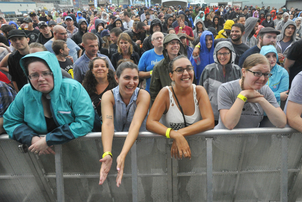 Fans listen to Chuck Regan, opening act for the Irish rock band Flogging Molly, at the Maine State Pier in August. Some neighbors say the loud music hurts their quality of life.