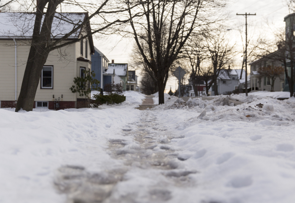 Ice covers a sidewalk on Whitney Avenue off outer Congress Street. Property owners who are disabled, sick or elderly can call the city's Office of Elder Affairs for help to clear walks.