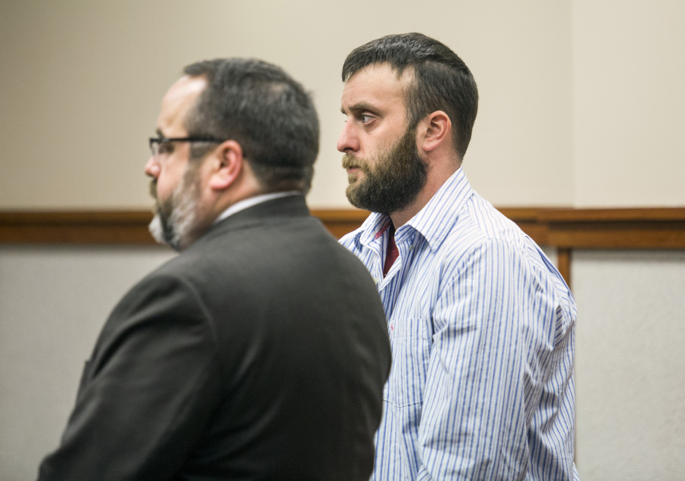 Jeffrey E. Smith Jr. stands with his attorney, Robert LeBrasseur, during a court appearance Wednesday. Smith is charged with leaving the scene of an accident that resulted in death, a felony.