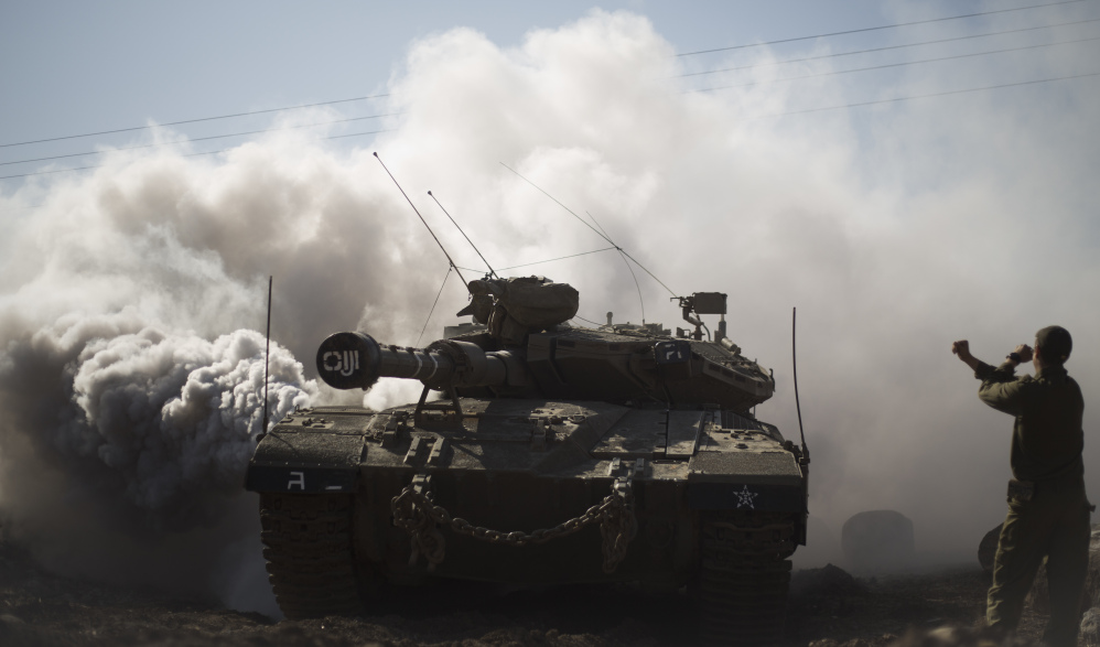 An Israeli soldier directs a tank in the Golan Heights last month. With Syria wracked by a civil war, Israel wants its control over the area to be recognized worldwide.