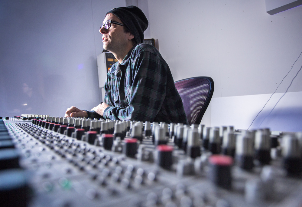 Nick Johnson, who plans to operate an all-analog recording studio in space he has secured on Anderson Street in Portland's East Bayside neighborhood, sits at the mixing board that he acquired in New Jersey.
