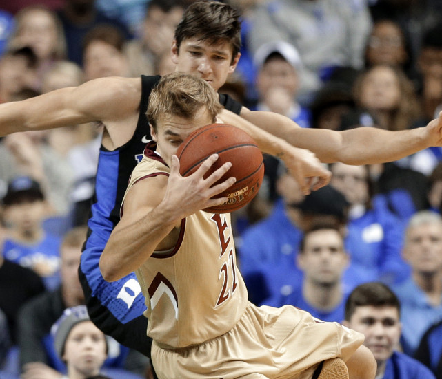 Steven Santa Ana of Elon heads to the floor Wednesday night, becoming the latest victim of Duke's serial tripper, guard Grayson Allen.