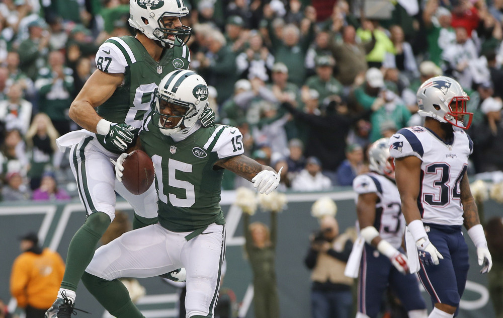 Brandon Marshall, 15, and the Jets helped prevent the Patriots from earning the No. 1 playoff seed last season, and will try to do it again Saturday at Gillette Stadium. Associated Press/Kathy Willens