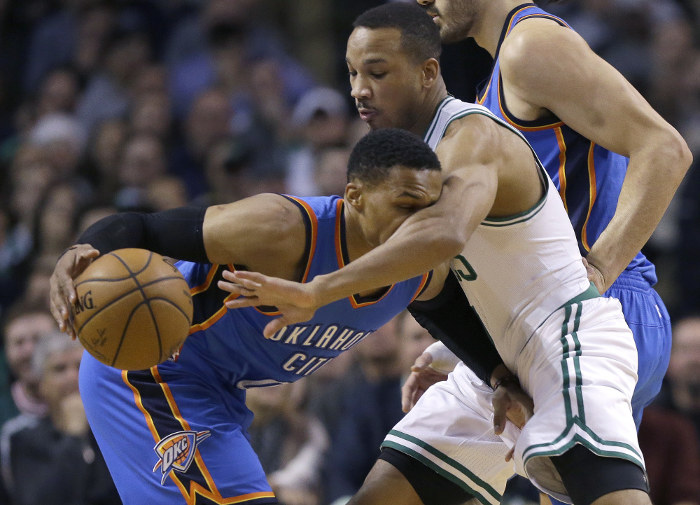 Oklahoma City Thunder guard Russell Westbrook, left, drives while being defended by Boston Celtics guard Avery Bradley during the first half of the Thunder's 117-112 win Friday in Boston.