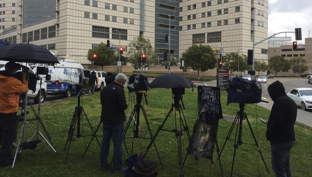 Media personnel camp outside the Ronald Reagan UCLA Medical Center in Los Angeles on Friday. Actress Carrie Fisher was admitted after suffering a medical emergency. Her mother, Debbie Reynolds, tweeted that she was in stable condition.