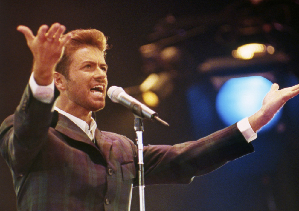 George Michael performs at the Concert of Hope to mark World AIDS Day at London's Wembley Arena in 1993. The singer who started out with the 80s group Wham! died Dec. 25 at age 53.