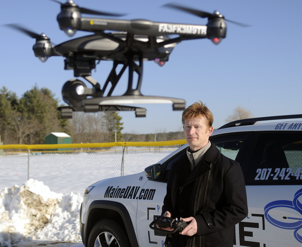 Photographer Thomas-john Veilleux operates a drone last week in Augusta while discussing the technological and regulatory hurdles he met to expand his business.