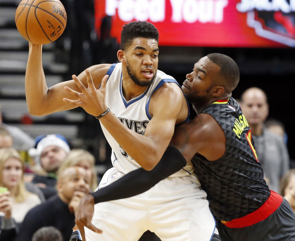Minnesota's Karl-Anthony Towns, left, looks to make a move against Atlanta's Paul Millsap during the Timberwolves' 104-90 win Monday in Minneapolis.