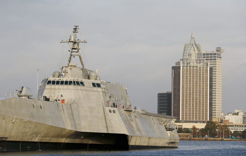 """The cityscape of Mobile, Ala., is seen behind the docked USS Gabrielle Giffords, a Naval littoral combat ship built at the Austal USA shipyards on the Mobile River. The ship is named in honor of former U.S. Rep. Gabrielle """"Gabby"""" Giffords of Arizona."""